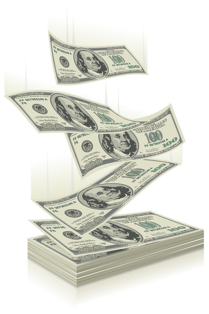 bigstock-flying-dollar-bills-the-conce-25566407