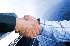 bigstock-Corporate-Deal--Blue-Handshak-resized