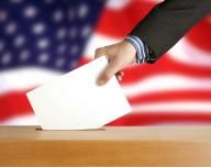 bigstock-Hand-with-ballot-and-box-resized