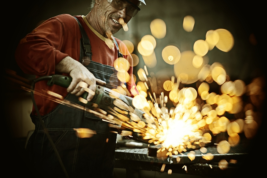 bigstock-Industrial-worker-cutting-and--60899459